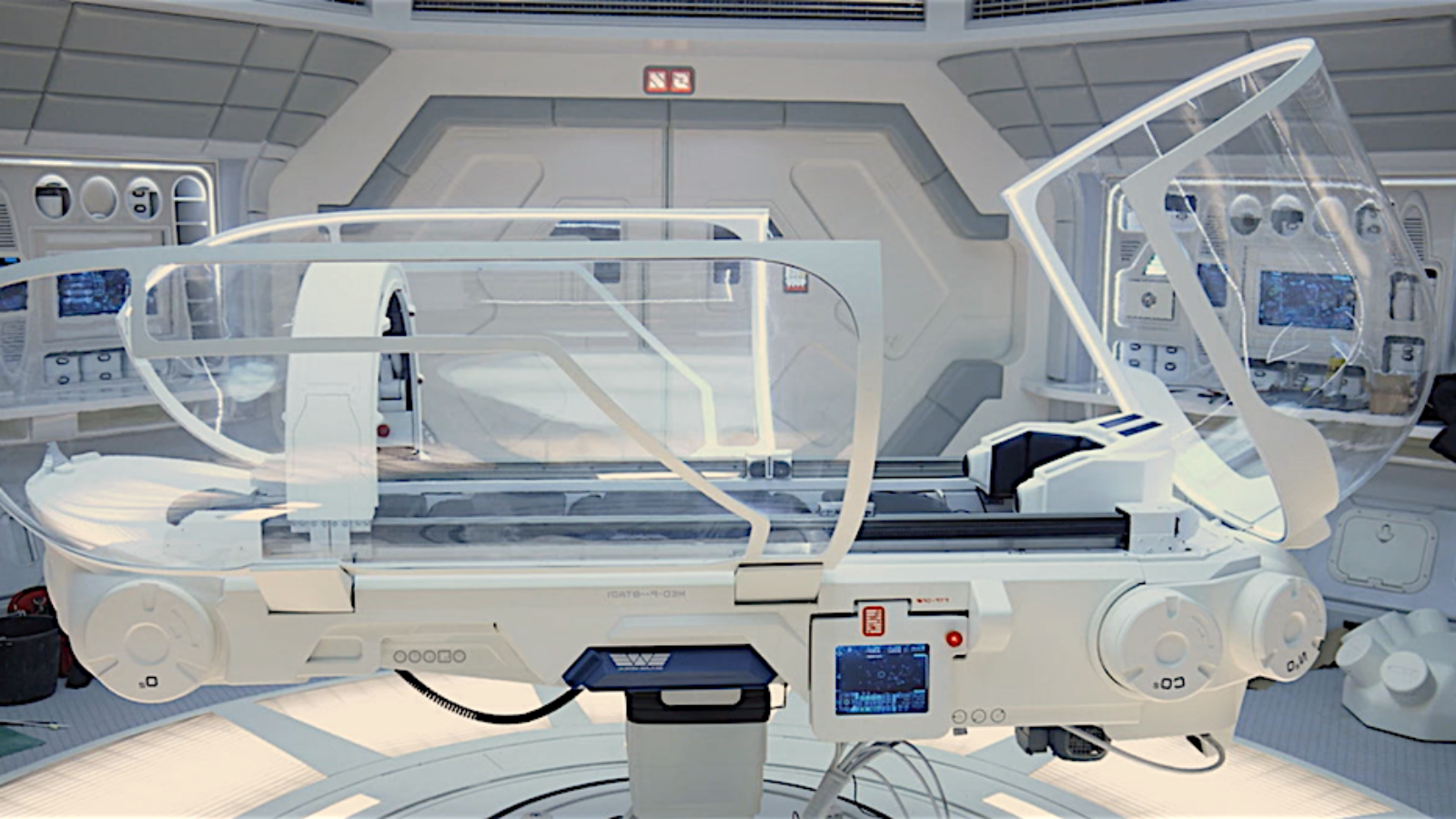Image is from the film Prometheus showing an advanced scanning and treatment bed.  What a Medbed will actually look like is not presently known.