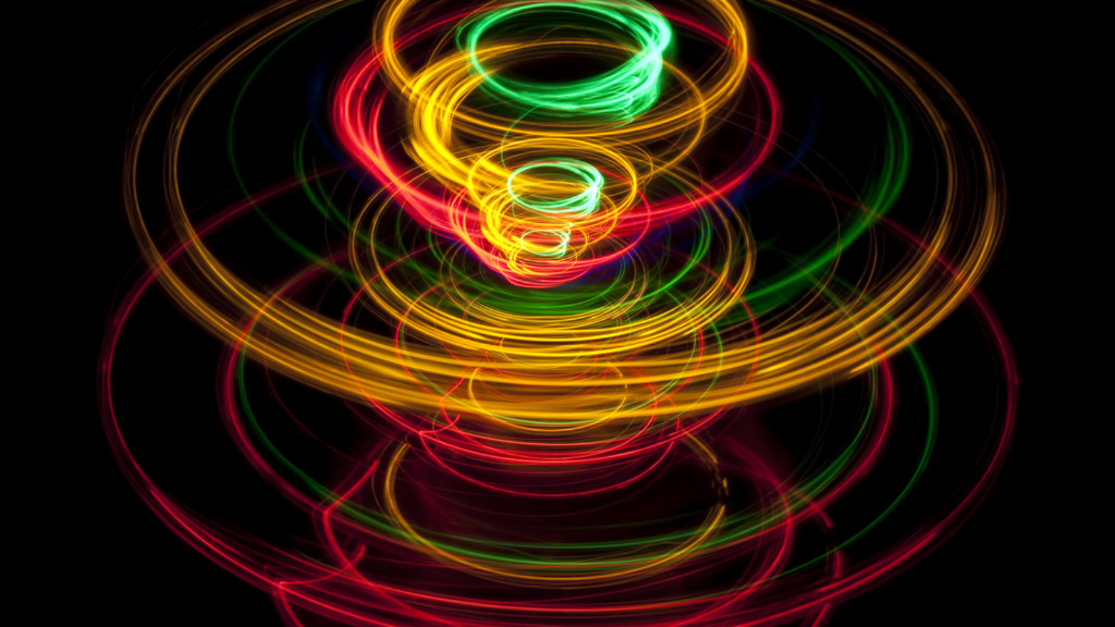 vivid lines of light tracing a pattern reminiscent of a spinning top toy