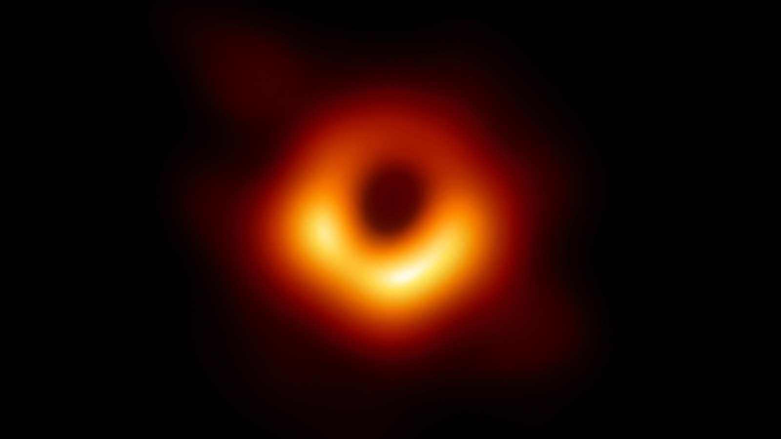The Event Horizon Telescope's image of the black hole at the center of Messier 87, a large galaxy in the Virgo cluster. This black hole resides 55 million light-years from Earth and has a mass 6.5 billion times that of the sun.
